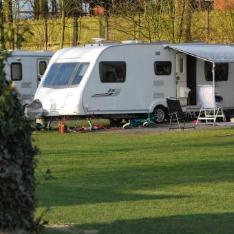 Caravan with awning at Moss Wood Caravan Park