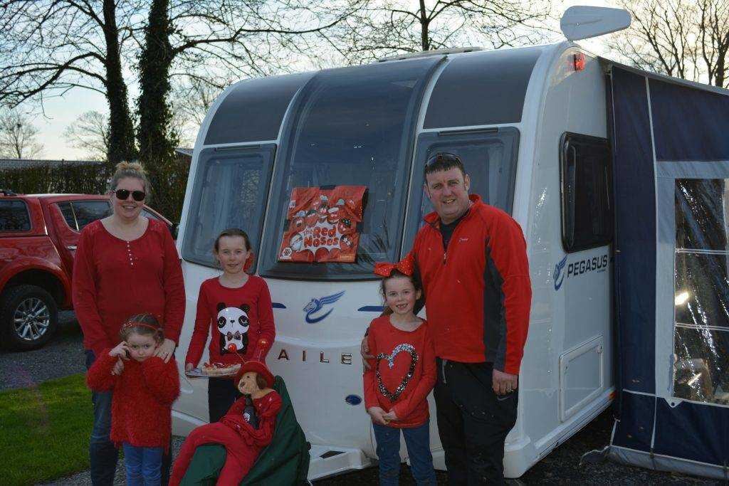 Touring caravan & family with decorated caravan