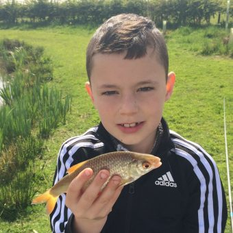 Joseph with fish at Moss Wood Caravan Park
