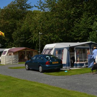 Touring caravans in summer at Moss Wood Caravan Park