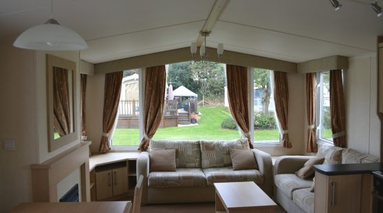 Living Room of Swift Bordeaux 2011 Caravan at Moss Wood Caravan Park