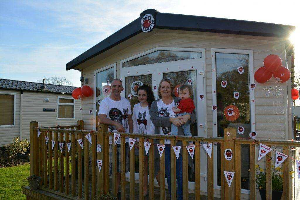 Static caravan & family with decorated caravan